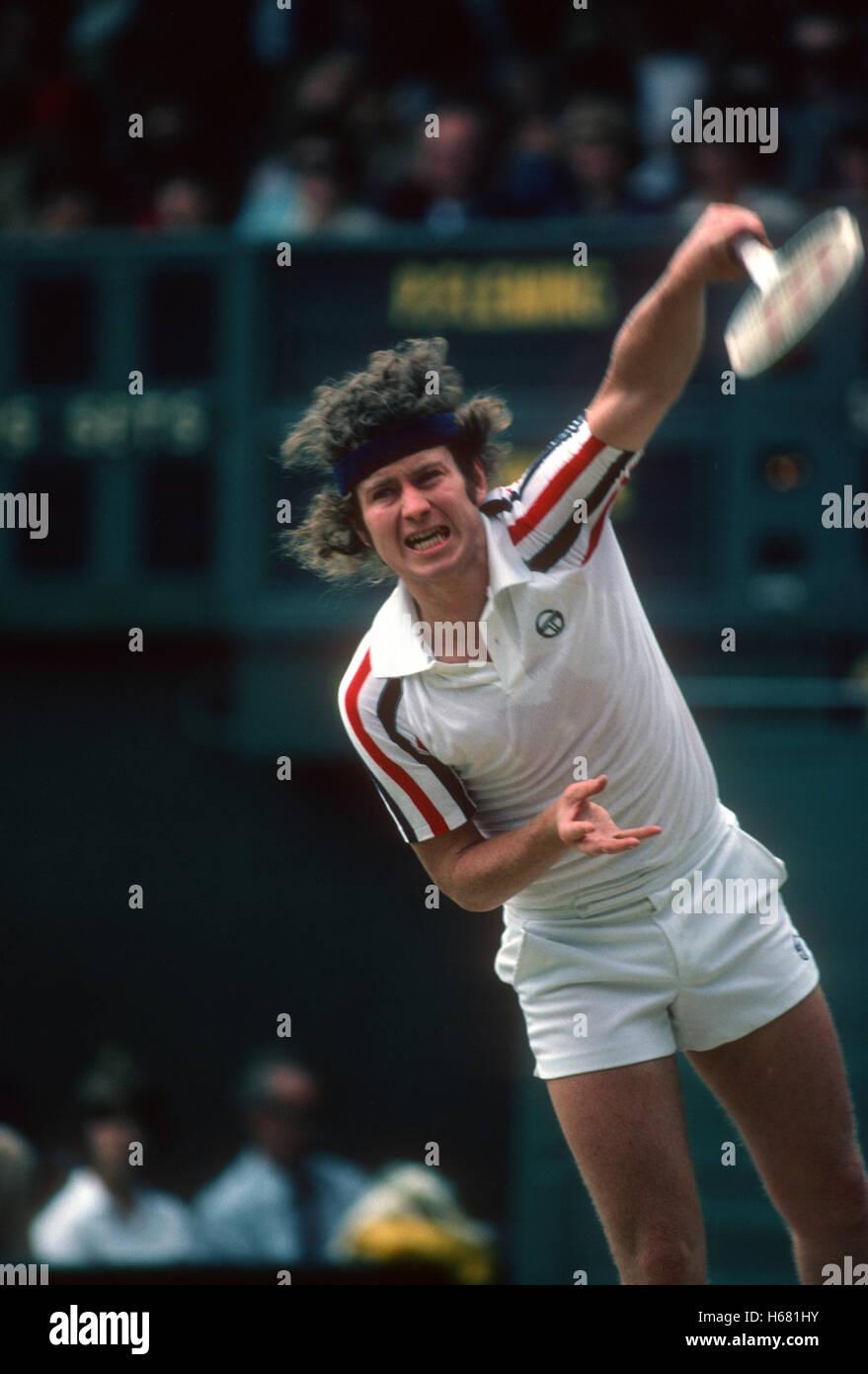 John McEnroe serving at Wimbledon 1980 Stock Royalty Free