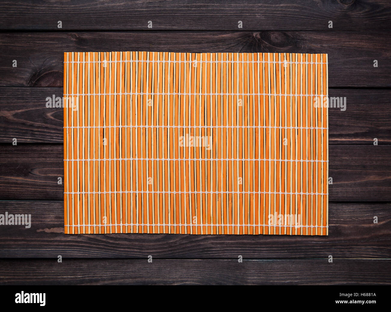 Stock Photo   Bamboo Mat On A Wooden Table, Top View