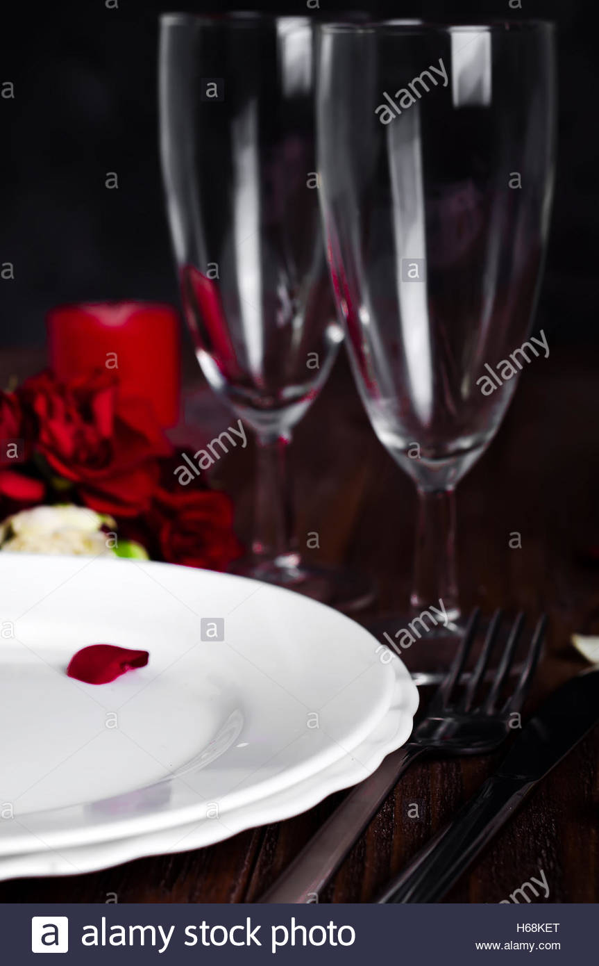 Candle Light Dinner Table Setting Part - 30: Romantic Valentine Candle Light Dinner Table Setting With Red Roses, Gift  And Burning Candles Against A Brown Background.