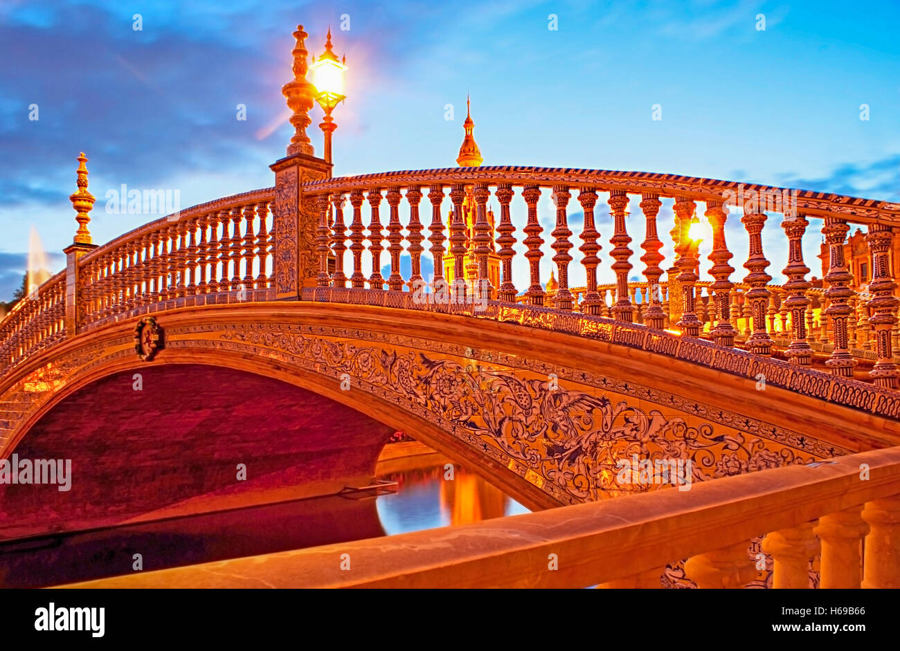 The tiny bridge decorated with painted tiles ceramic hand rails the tiny bridge decorated with painted tiles ceramic hand rails and scenic streetlights spain square seville spain dailygadgetfo Images
