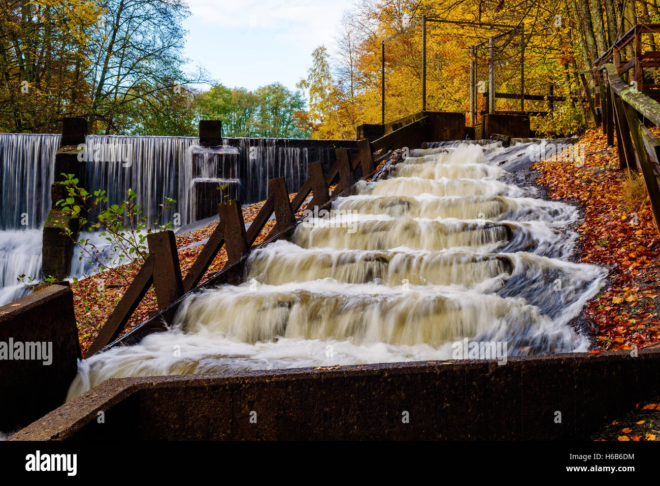 Background image overflow - Fish Ladder With Rapids In Fall Woodland Landscape Overflow Of Water Create Waterfall In Background The River Braknean In Sout