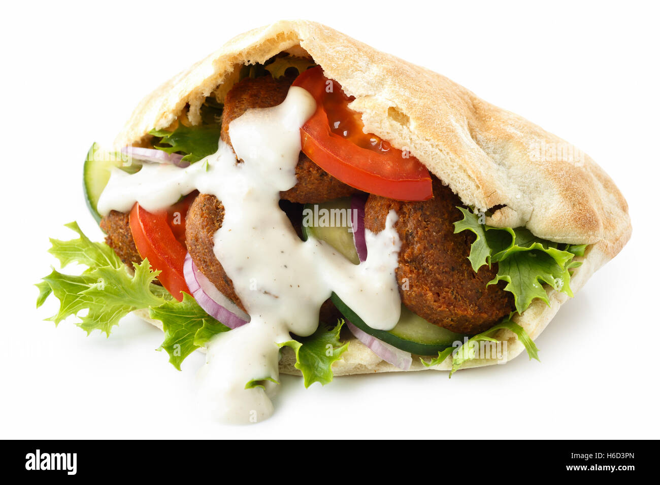 Pita bread filled with falafel, salad and white sauce ...