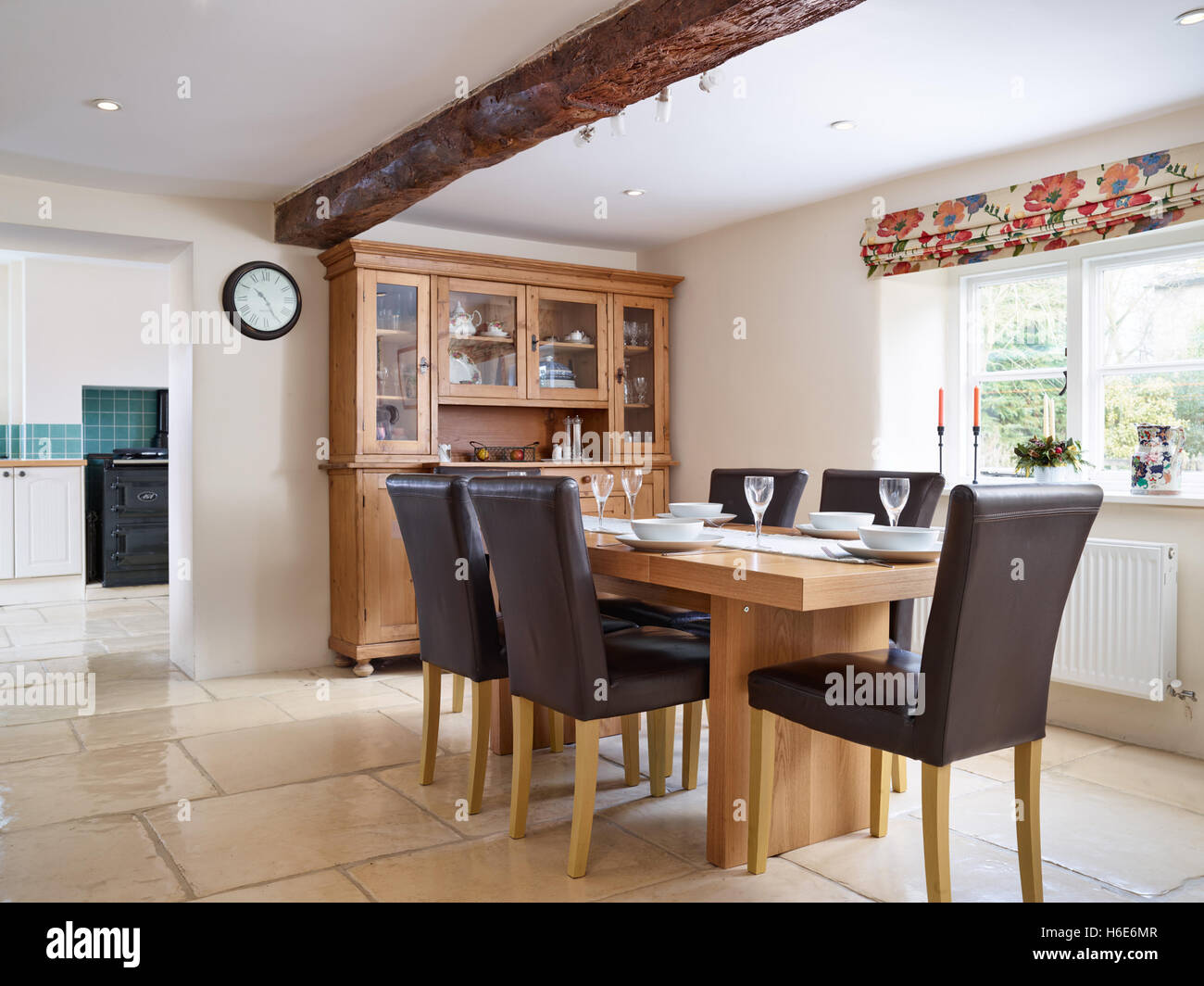 An Oak Table Set For 6 In A Large Dining Room Adjacent To Kitchen