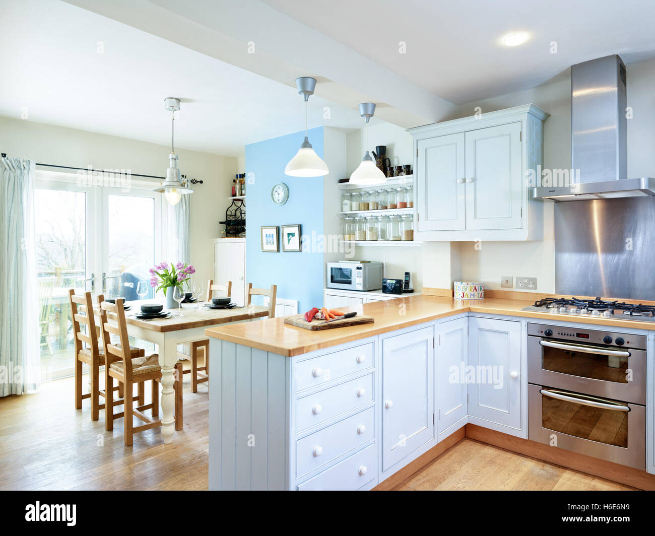 open oven in kitchen. a contemporary, open kitchen dinner incorporating an integrated oven, cooker, hood \u0026 wood oven in
