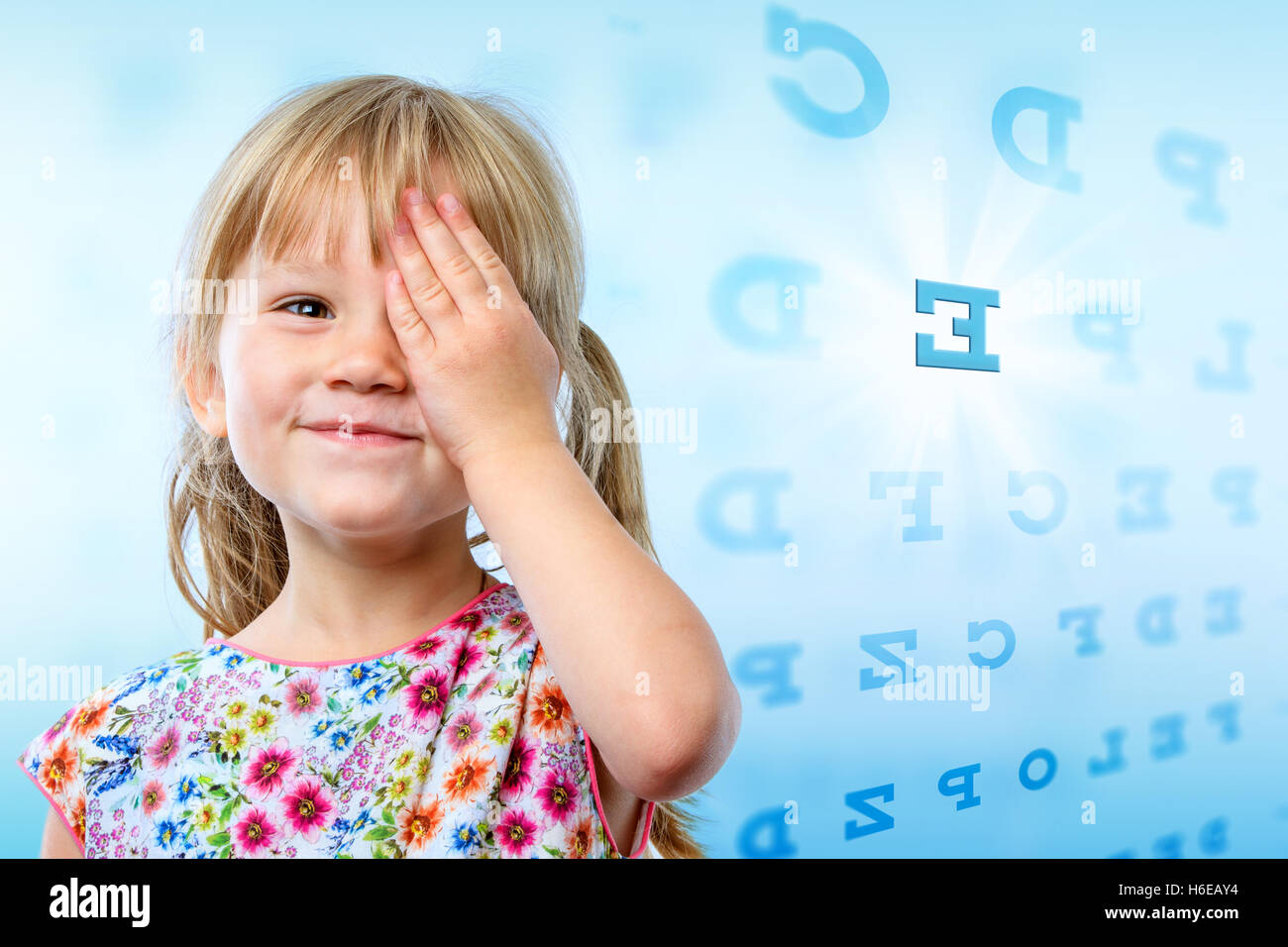 Close up portrait of little girl reading eye chart young kid close up portrait of little girl reading eye chart young kid testing one eye on block letter vision chart nvjuhfo Image collections