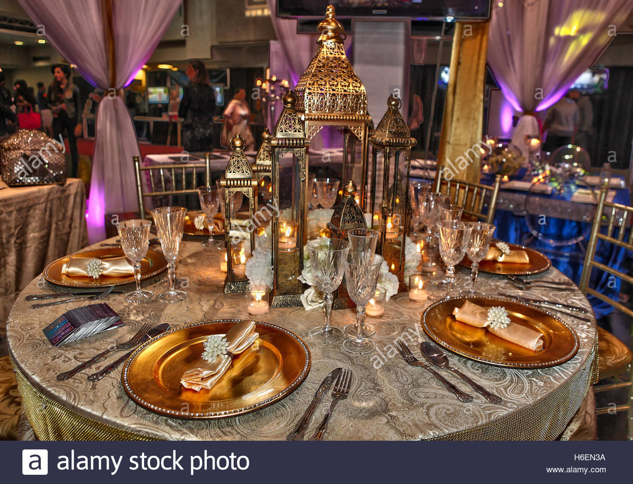 Elaborate Table Setting Decorated With Fancy Napkins, Candles, And Lanterns.