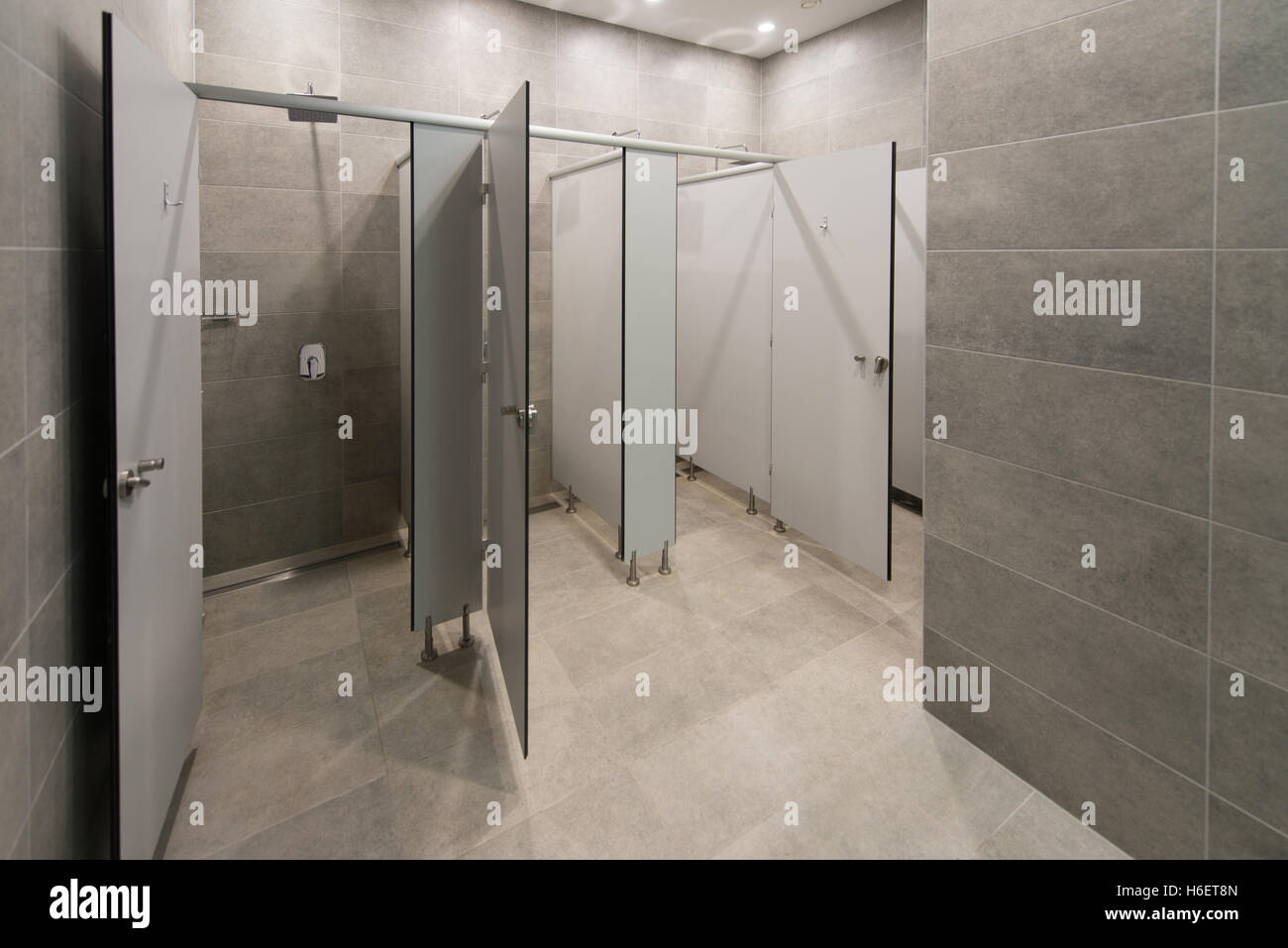 Modern interior of a shower room in fitness center gym