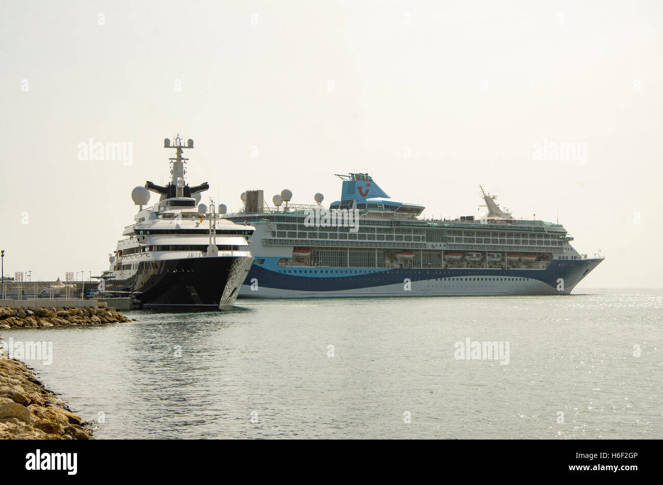 Modern Cruise Line TUI Discovery And Mega Yacht Octopus In The Port Of Malaga Costa Del Sol Spain