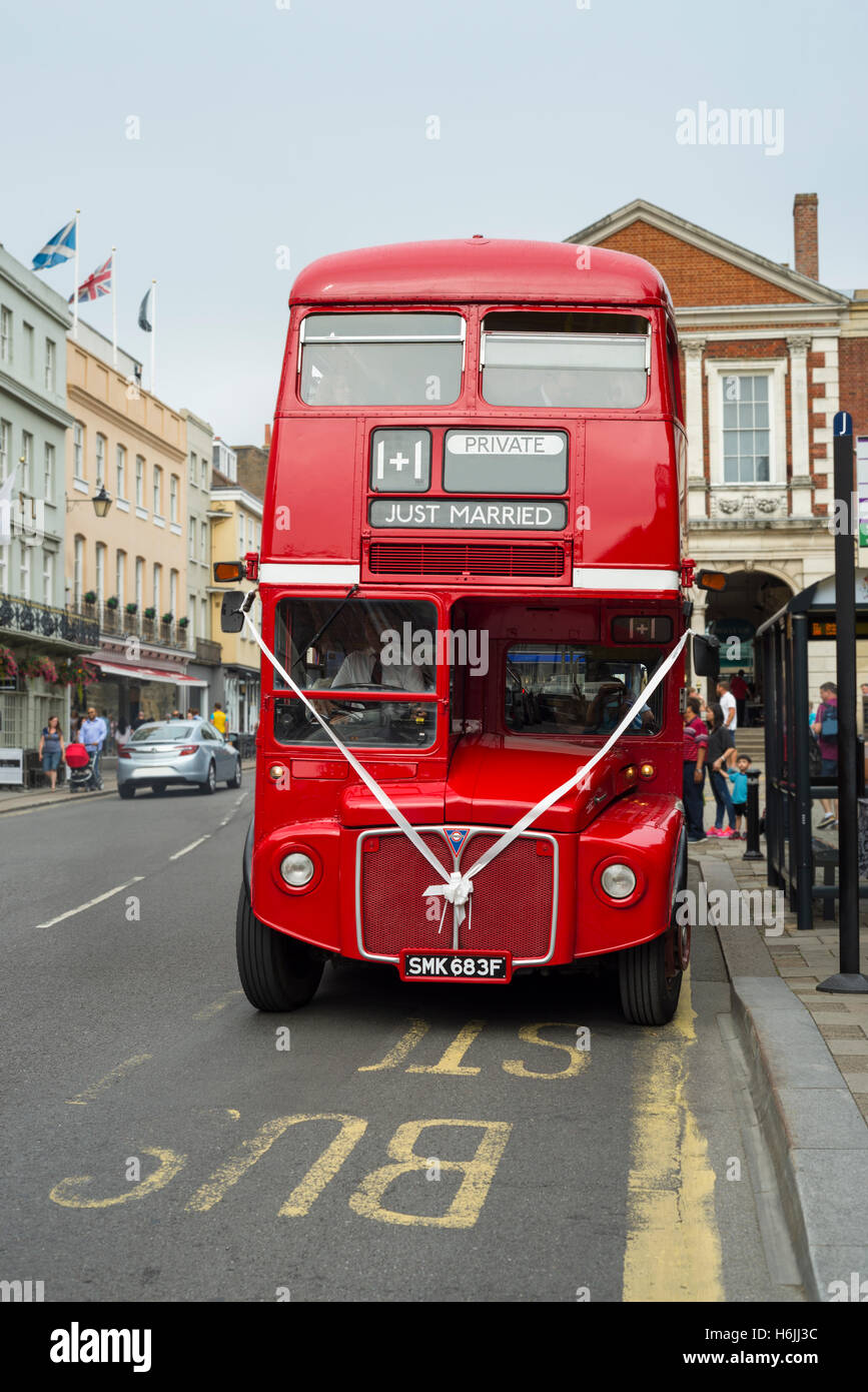 Traditional British Red Routemaster Double Decker Bus With Marriage Decoration For A Wedding Ceremony At Bust Stop In Street Windsor UK