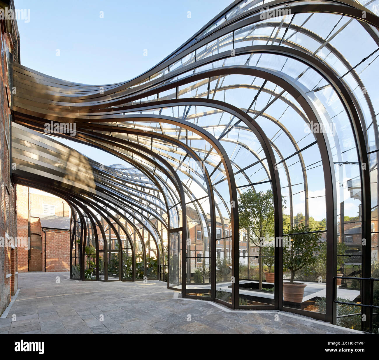 Curved greenhouse structures forming archway bombay for Architectural greenhouse