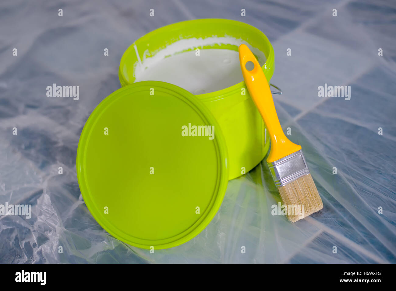 Yellow Paint Brush And Green Bucket On The Floor, Ready For Housework  Project And Walls Redecoration