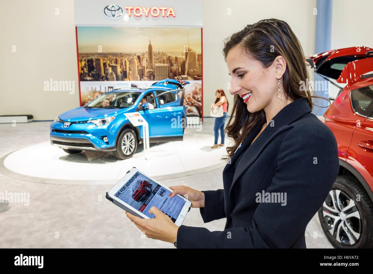 Florida miami beach convention center centre interior international auto show new models shopping toyota woman representative