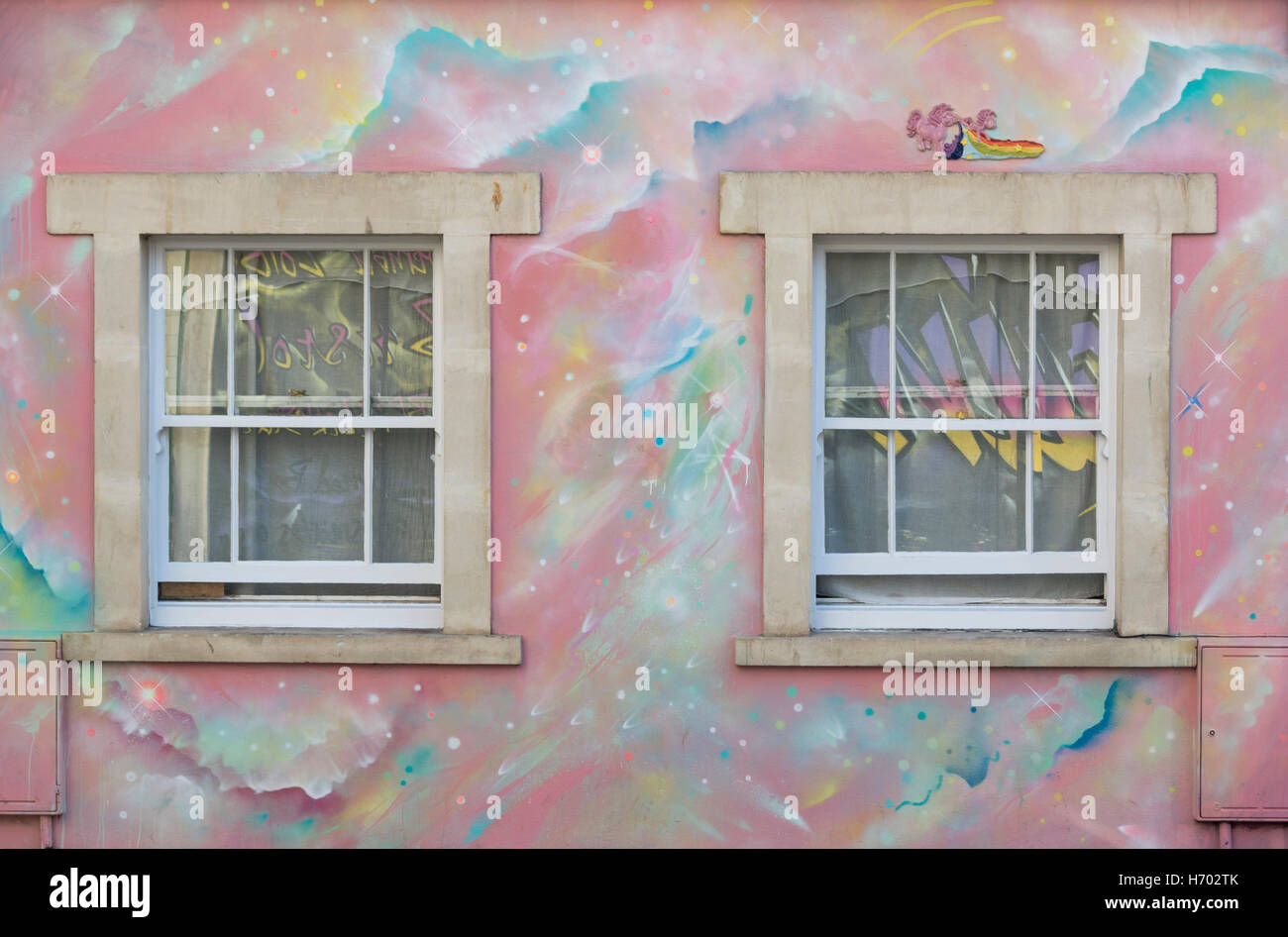 Unicorn wall murals images home wall decoration ideas two windows surrounded by a rainbow painted wall mural with two windows surrounded by a rainbow amipublicfo Image collections