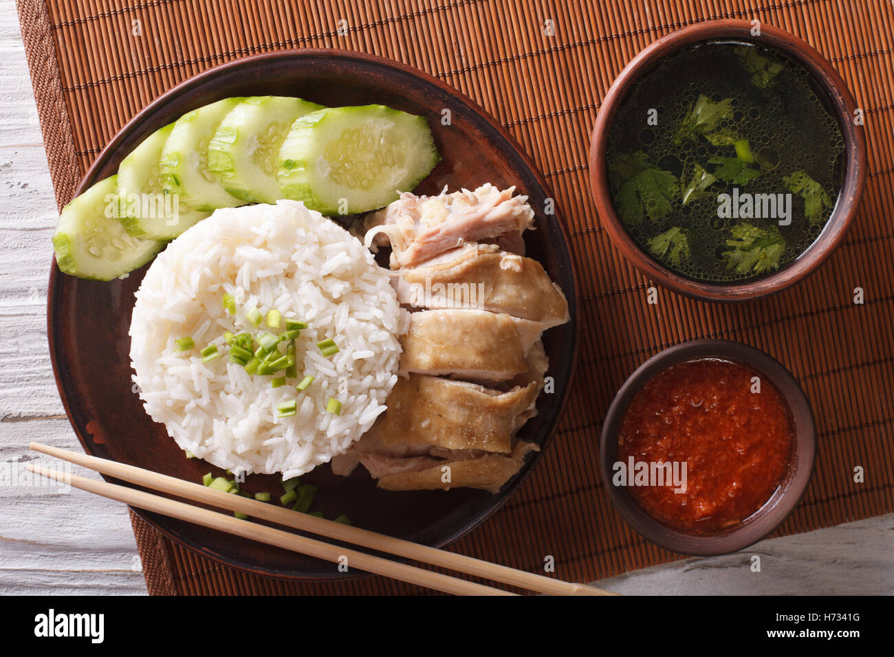 Hainanese Chicken Rice Close Up On A Table Chili Sauce And Broth Horizontal View From Above