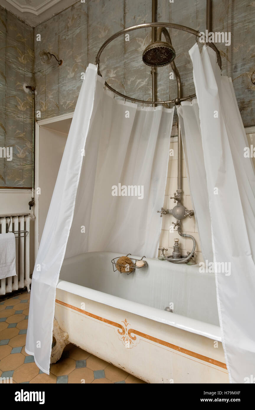 Shower curtain over freestanding bath in 18th century Chateau de ...