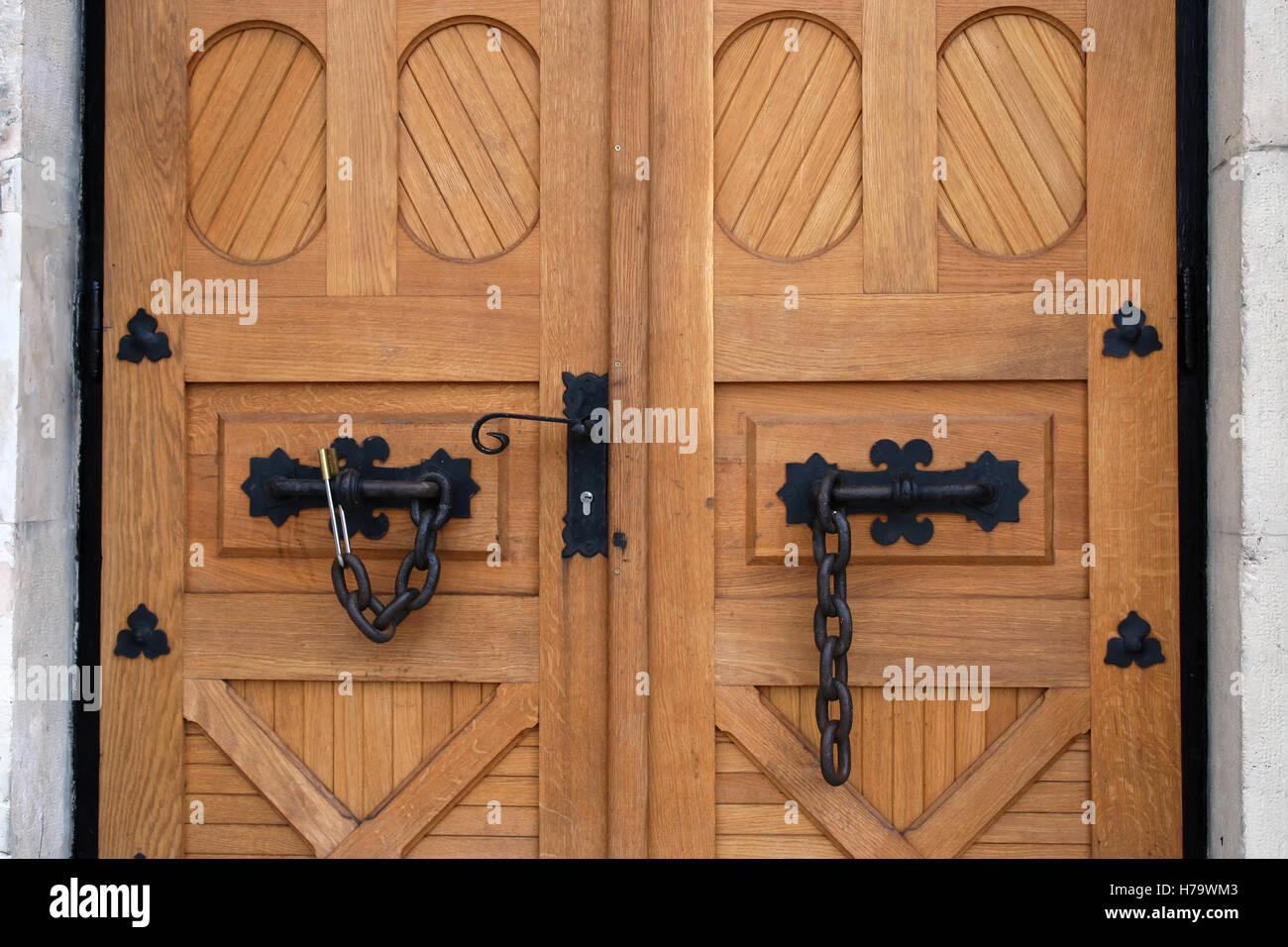 Old wooden doors. Old heavy wood door Stock Photo, Royalty Free ...