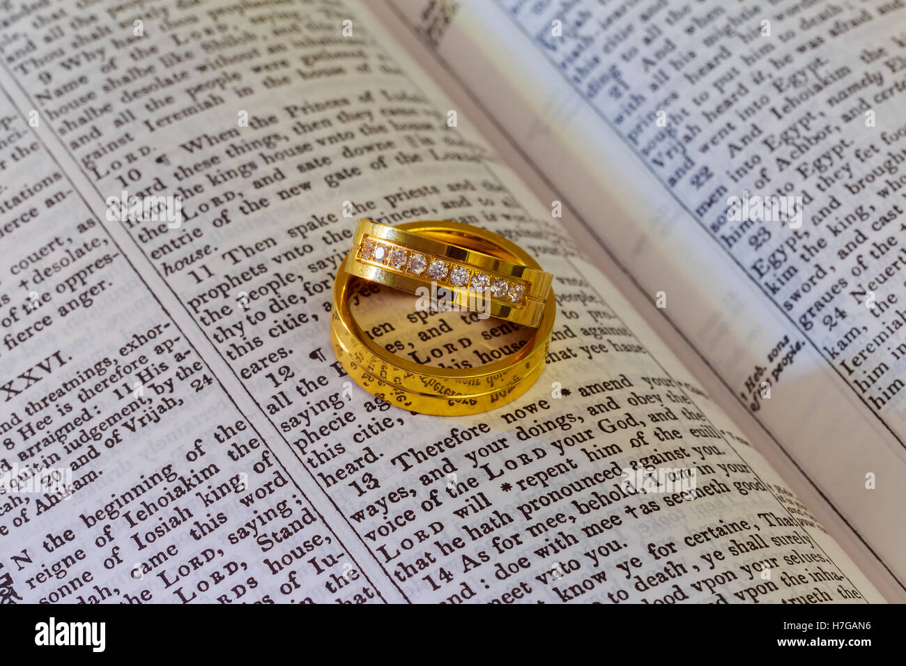 Two wedding rings on a bible Wedding rings Bible Stock Photo