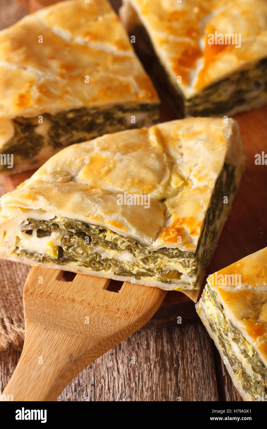 Greek Pie With Spinach And Cheese Spanakopita Close Up On A Table. Vertical