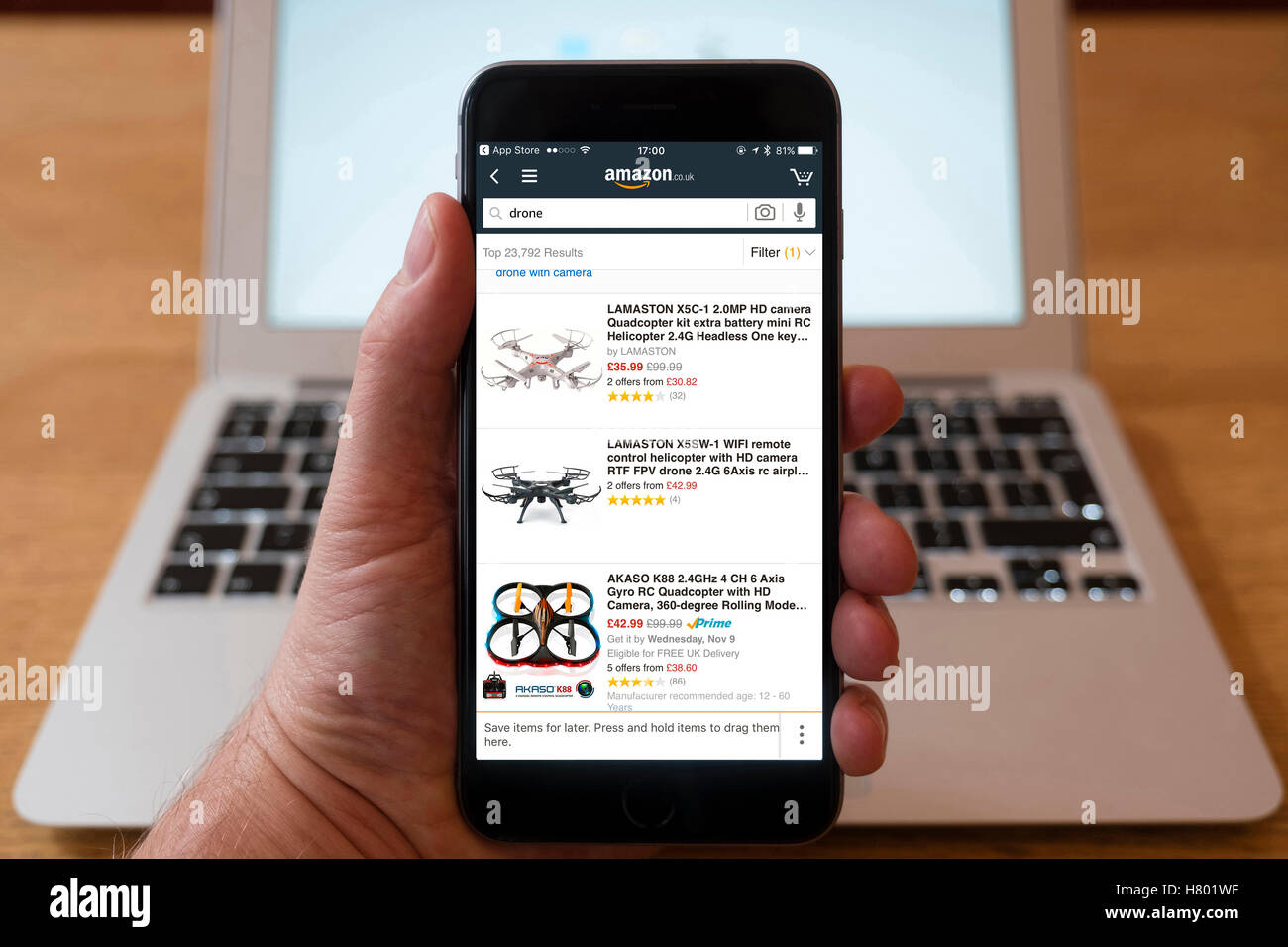 Using IPhone Smartphone To Display Amazon Online Store With Modern Drones For Sale