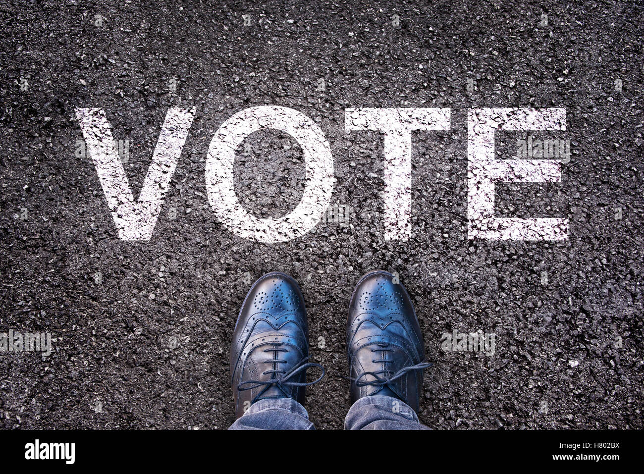 Legs and shoes on asphalt with the word vote stock photo royalty legs and shoes on asphalt with the word vote publicscrutiny Images