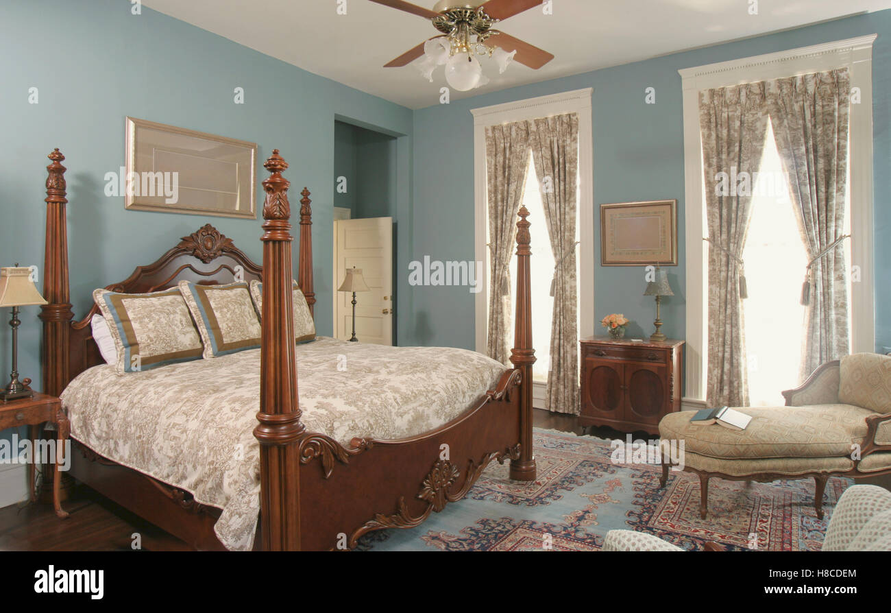 Four Poster Double Bed Part - 33: Stock Photo - Wooden Four Poster Double Bed In Blue Bedroom