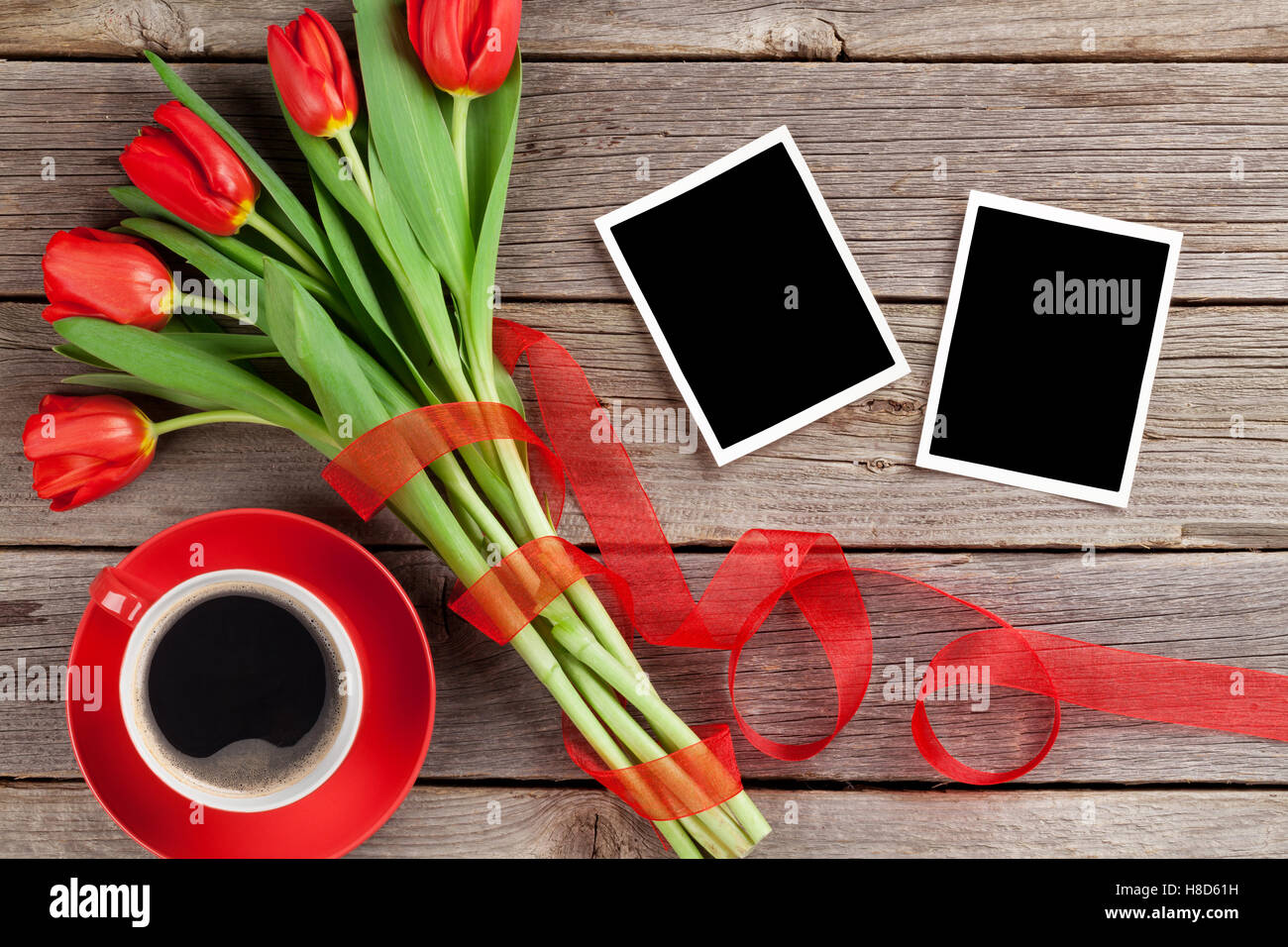 Coffee cup frames - Red Tulips Bouquet Photo Frames And Coffee Cup Over Wooden Table Top View With Copy Space