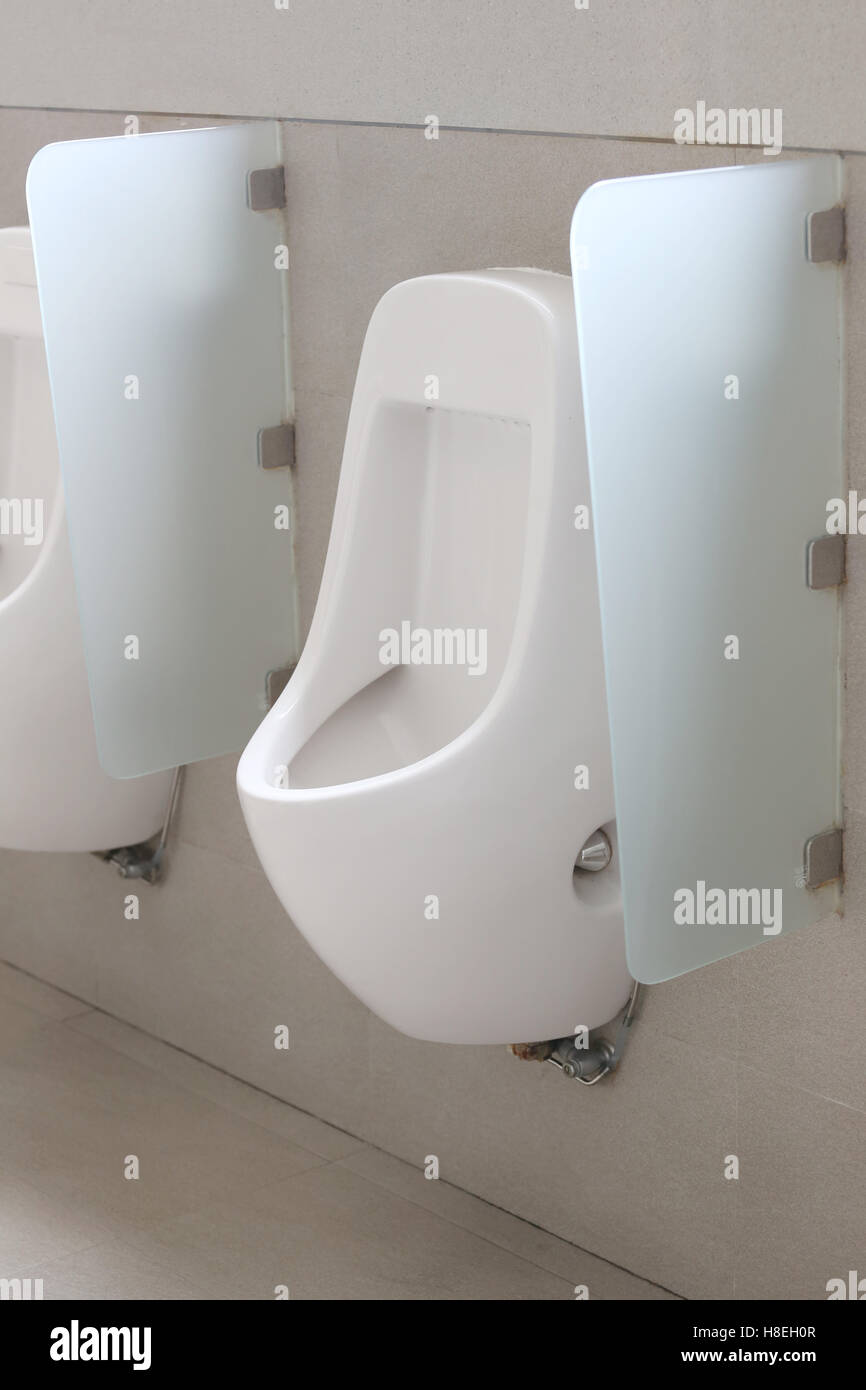 Modern Urinal In Men Bathroom, White Ceramic Urinals For Men In Toilet Room.