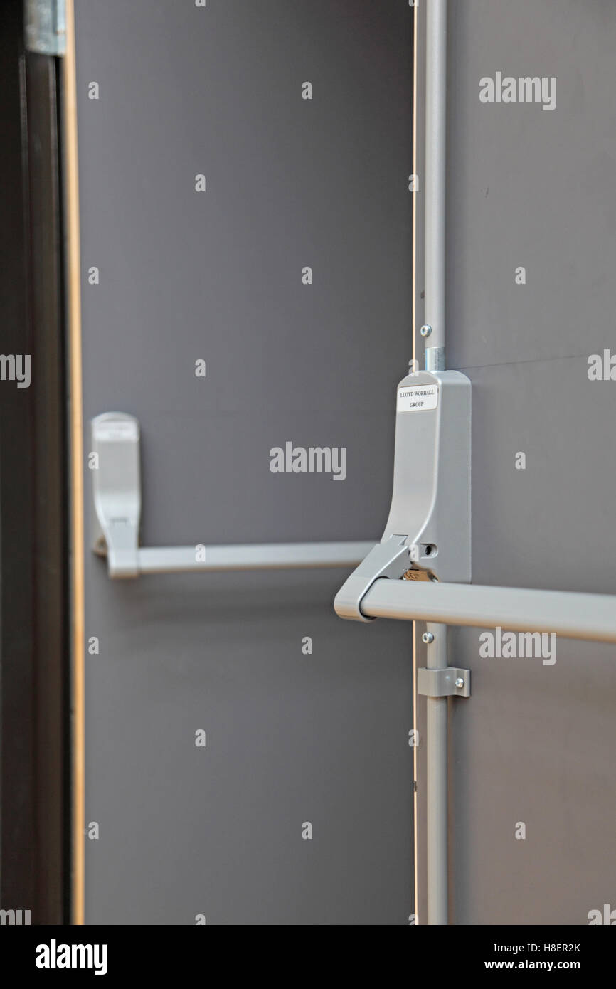 Closeup of a fire escape door in a modern London school. Shows detail of push-bar and panic bolt system & Closeup of a fire escape door in a modern London school. Shows ... pezcame.com