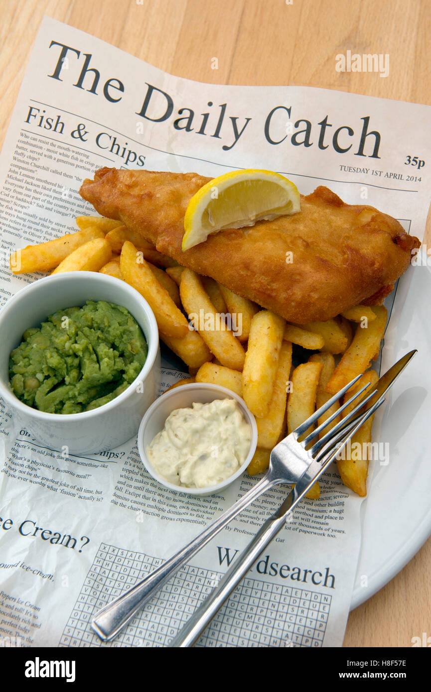 Traditional british fish chips served in a newspaper a for Fish and chips newspaper
