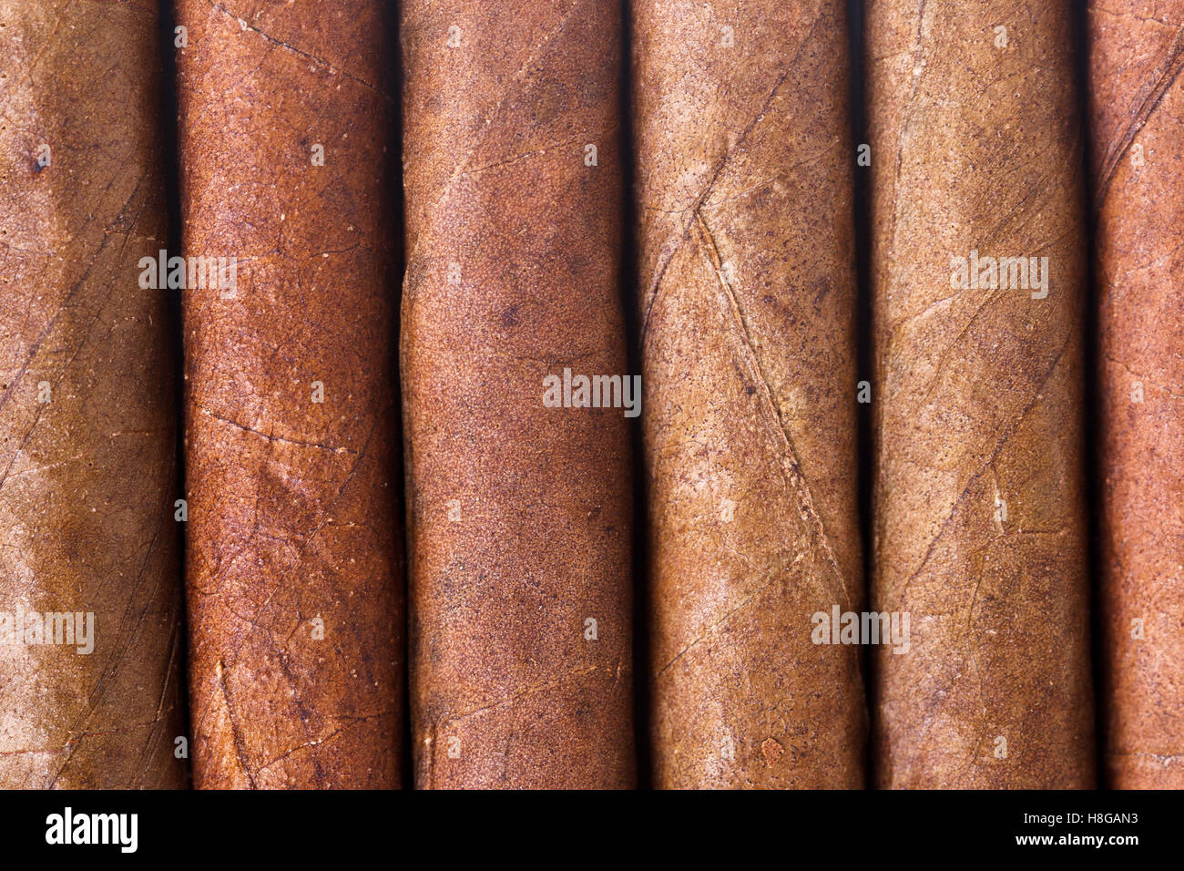 Chocolate cigars in row as background Stock Photo, Royalty Free ...