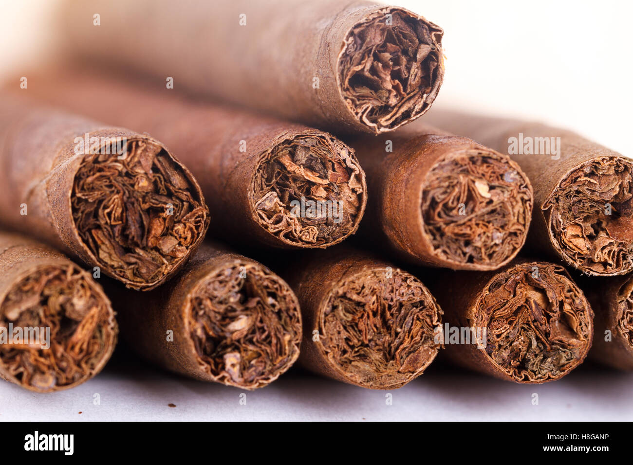 Chocolate cigars in row on white background Stock Photo, Royalty ...