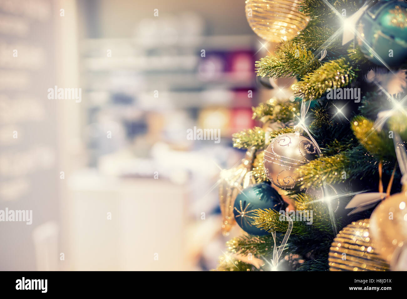 christmas tree with gold decoration in shopping clearance sales at the shopping mall - Christmas Trees Clearance