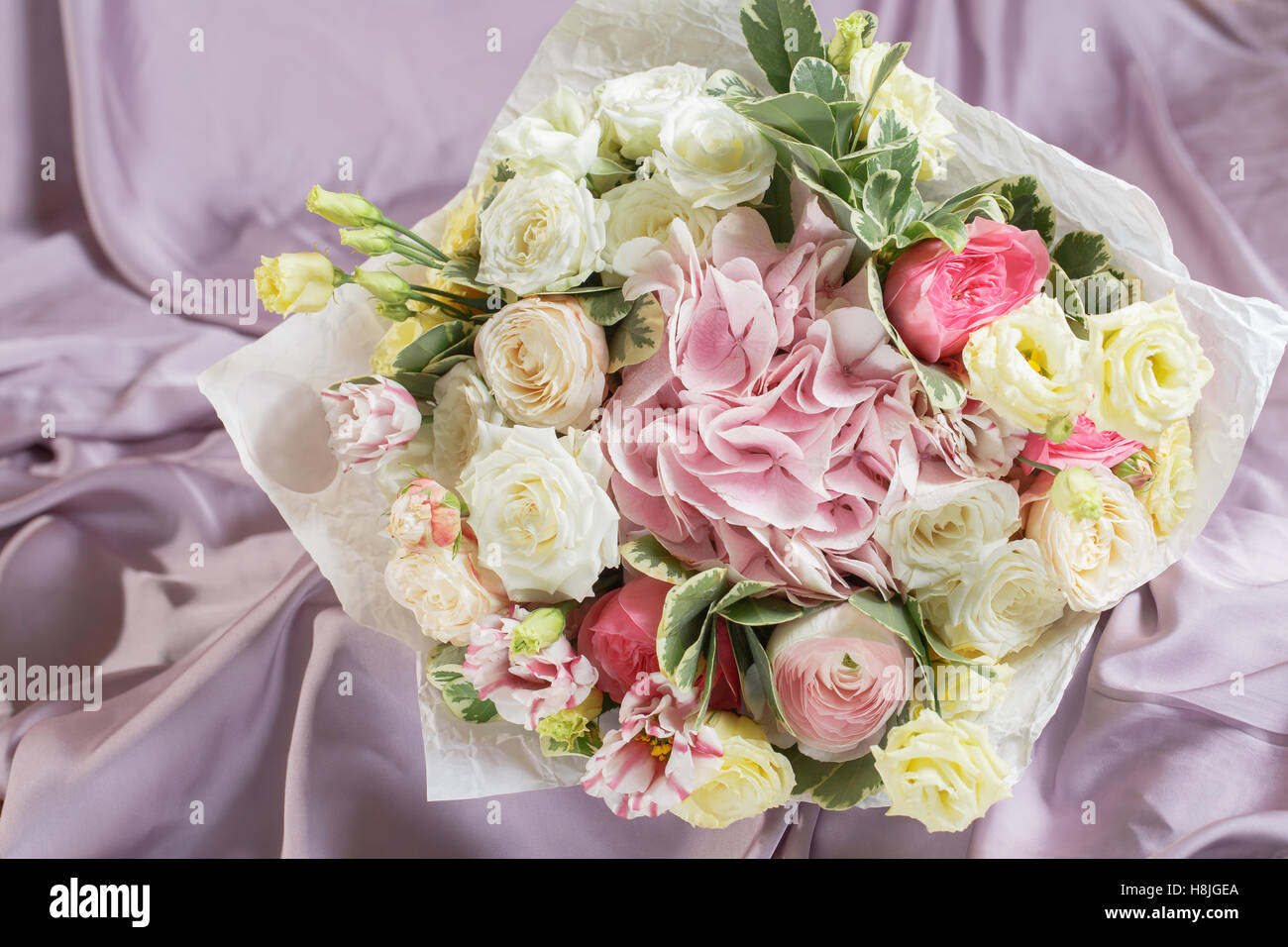 Beautiful bouquet made of different flowers colorful color mix beautiful bouquet made of different flowers colorful color mix flower on a table covered with cloth izmirmasajfo Gallery