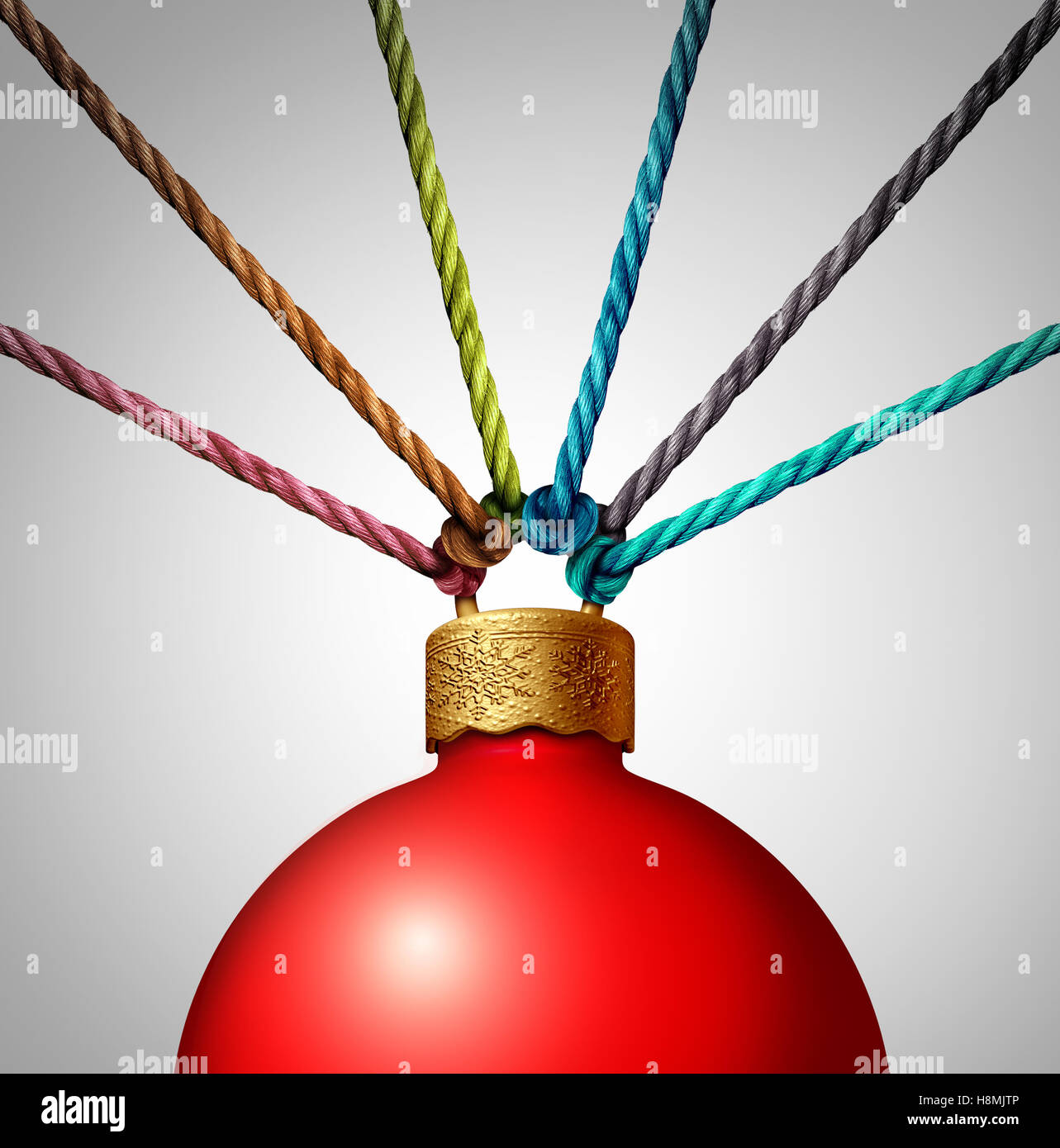 Together for christmas charity concept helping and providing stock together for christmas charity concept helping and providing volunteer support as a group of ropes holding a winter holiday ornament as a festive symbol for biocorpaavc