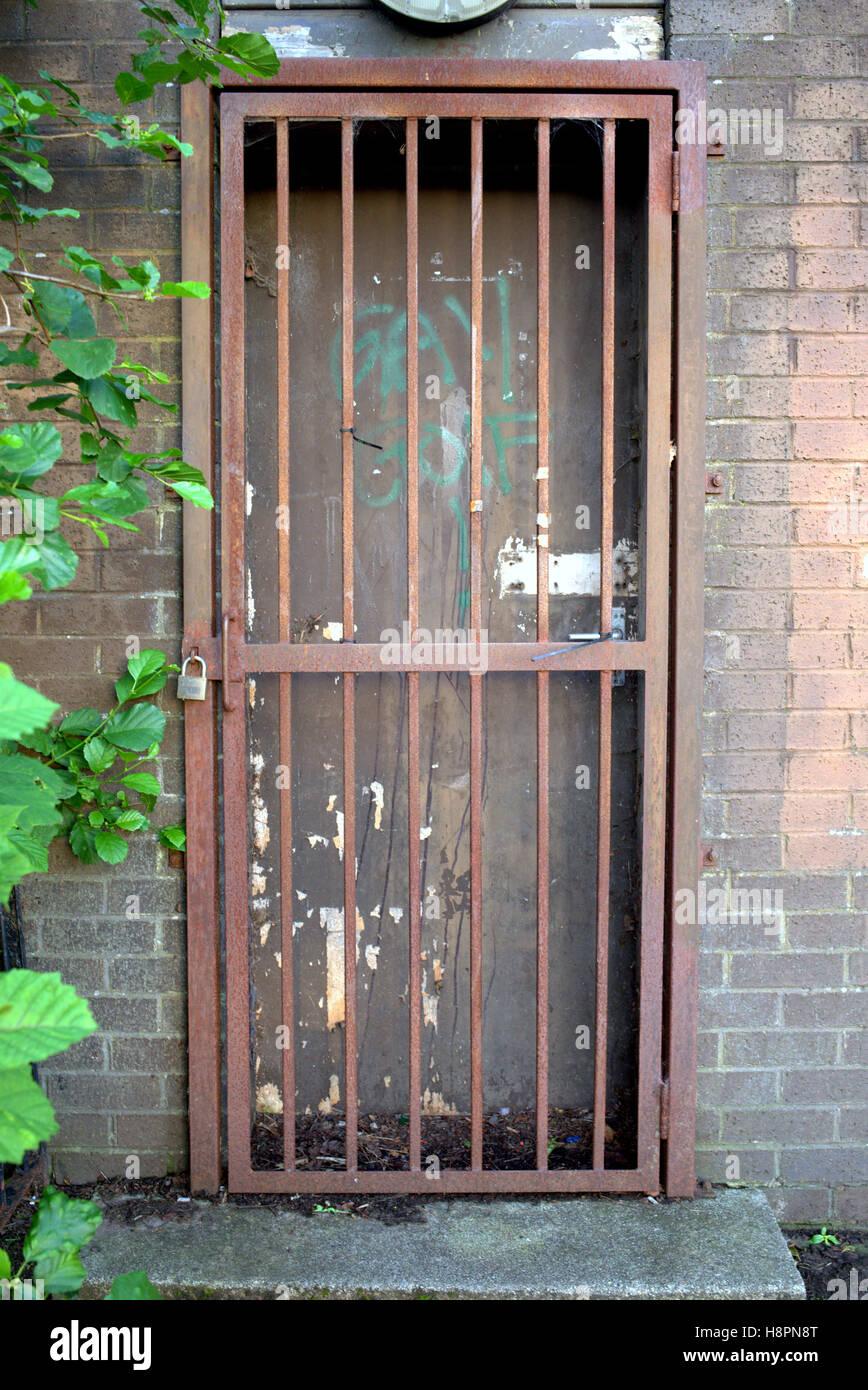 locked bars gate door red rusty grill brick wall Stock Photo ...