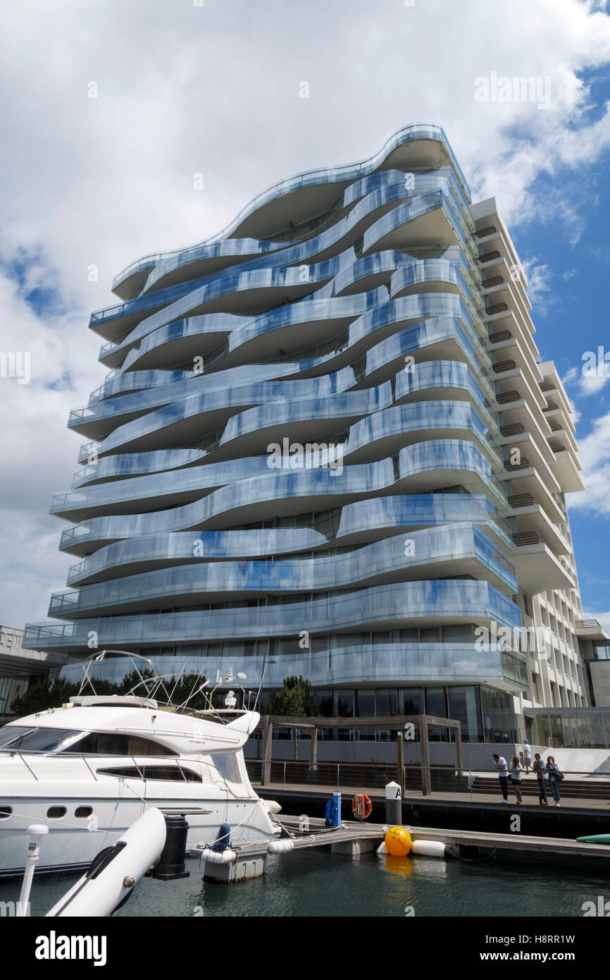 Curved Architecture Building With Modern Architecture And Curved Glass Balconies Stock