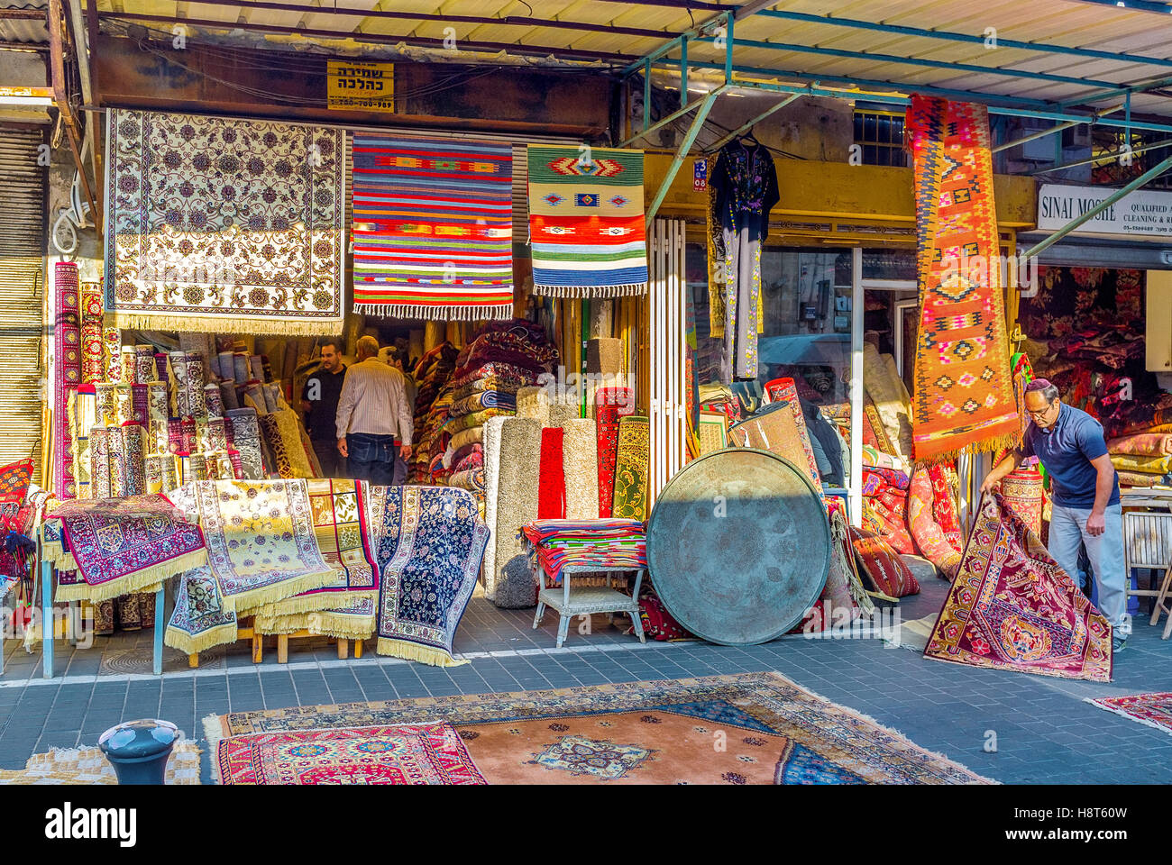 Stock Photo   The Rug Store In The Flea Market Of Jaffa, Is The Best Place  To Choose New Or Used Kilim, Or Watch The Making Of Rug Patchwork