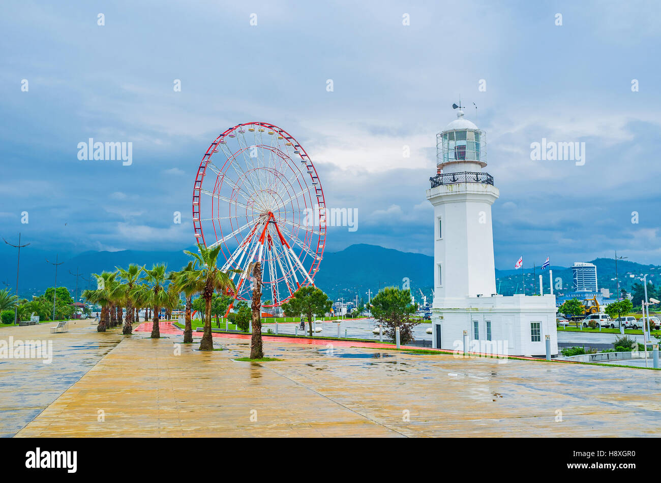 The white lighthouse and the ferris wheel on the coast are the the white lighthouse and the ferris wheel on the coast are the city symbols biocorpaavc