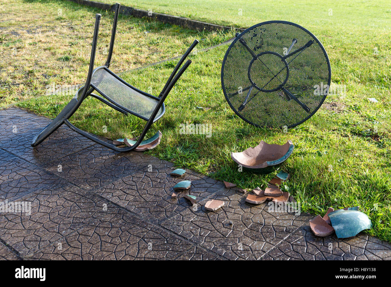 Garden Furniture Kerry blown over garden table and chairs and broken ceramic plant pot