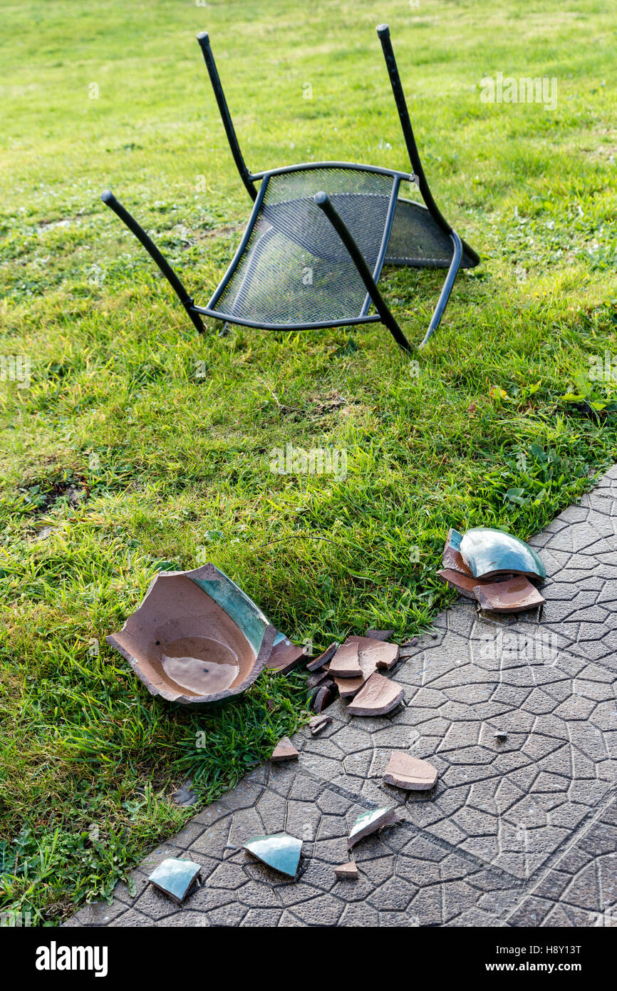blown over garden table and chairs and broken ceramic plant pot caused by high winds valentia island county kerry ireland
