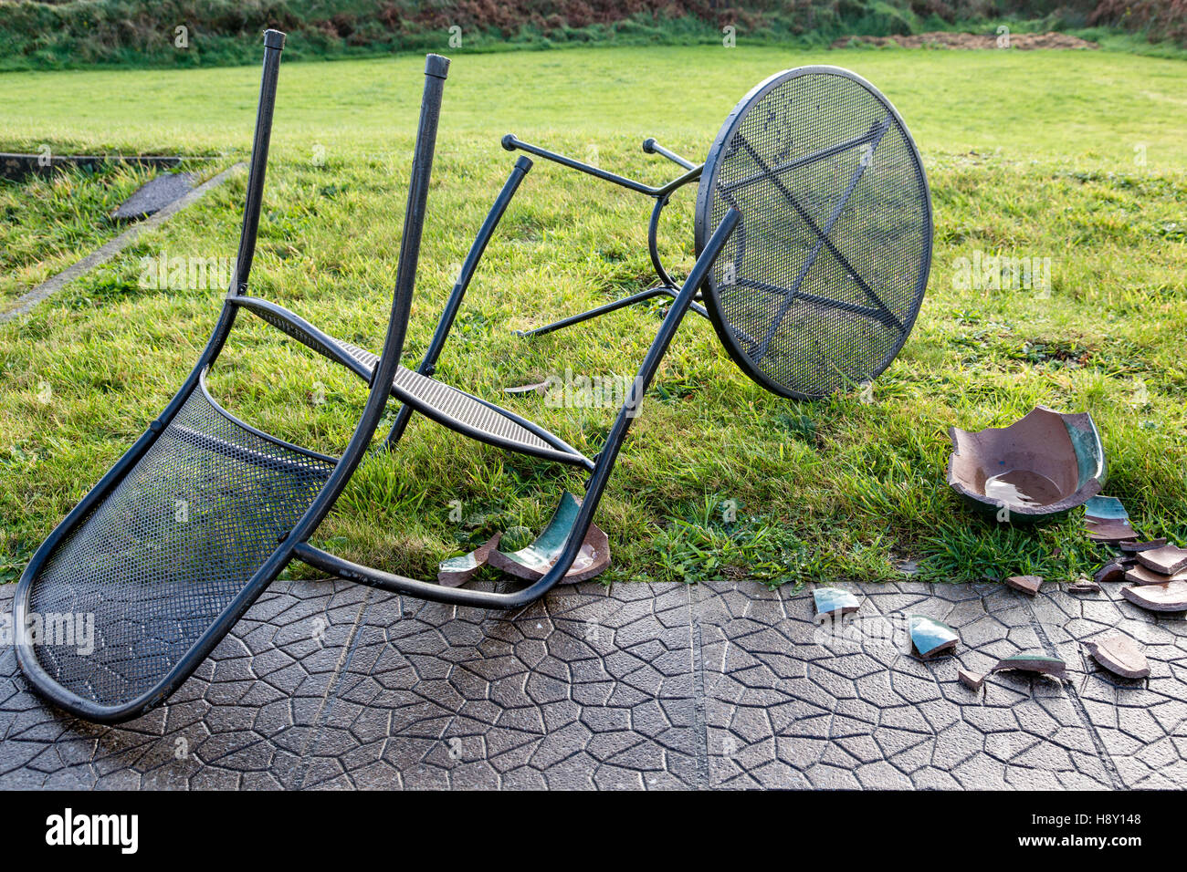 Blown Over Garden Table And Chairs And Broken Ceramic Plant Pot, Caused By  High Winds. Valentia Island, County Kerry Ireland.