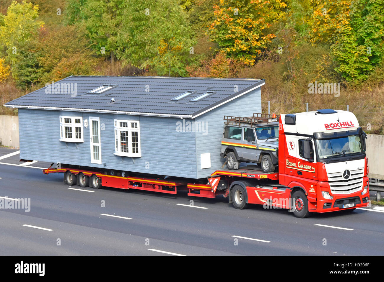 Side View Logistics Transporting Prefabricated House Park Home Prefab Lodge Housing On Hgv Low Loader Delivery