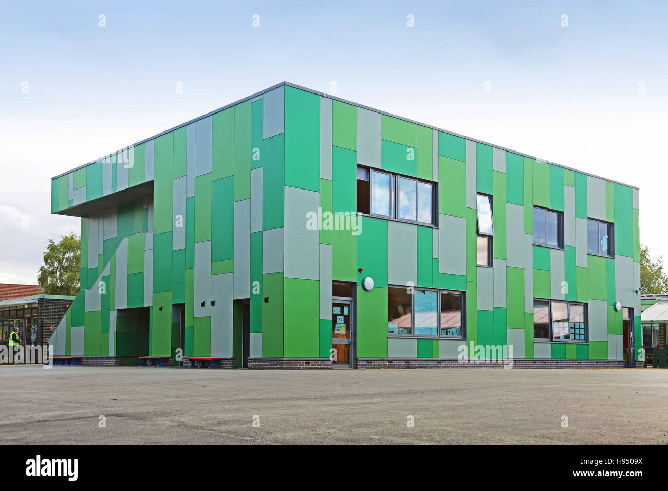 exterior architectural panels. exterior of a new school classroom block clad in spectacular green and grey architectural panels. abbey wood, east london panels