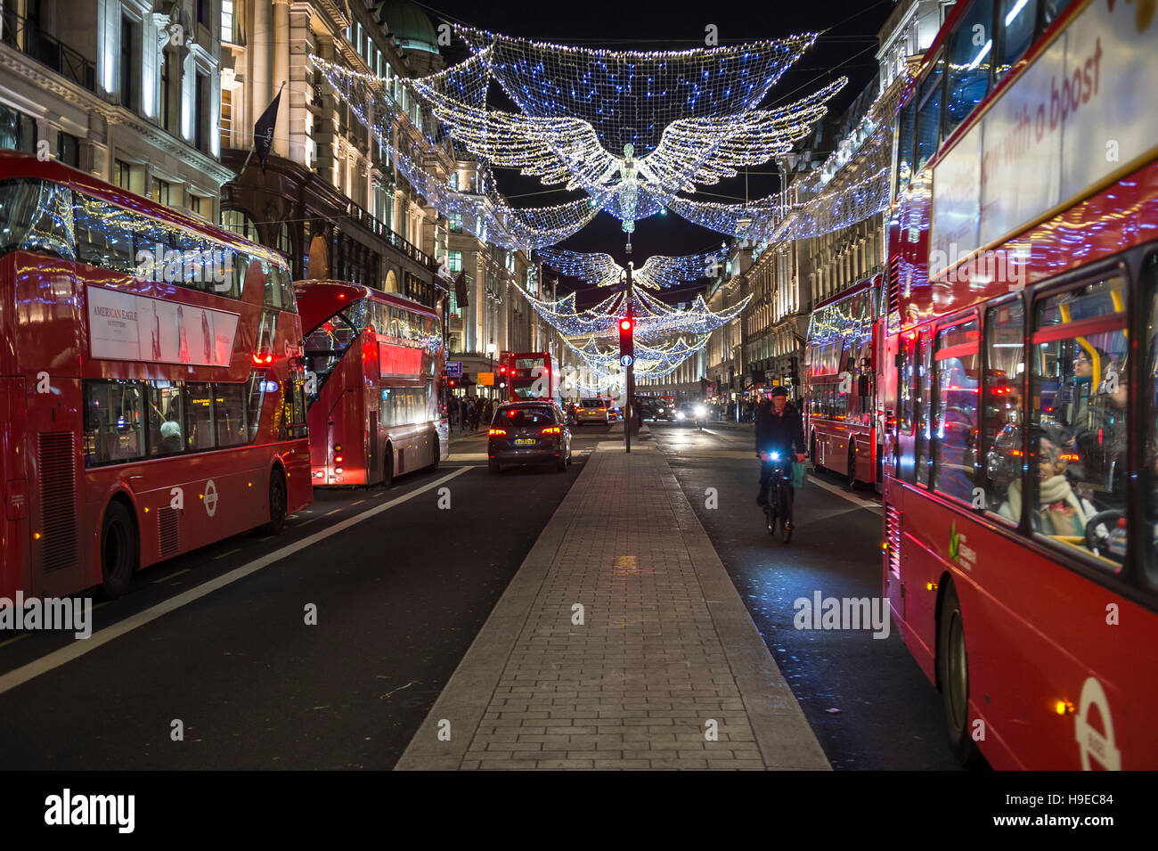 LONDON - NOVEMBER 18 2016 Red double-decker bus pass under twinkling Christmas angels lighting up the upscale Regent Street & LONDON - NOVEMBER 18 2016: Red double-decker bus pass under Stock ... azcodes.com