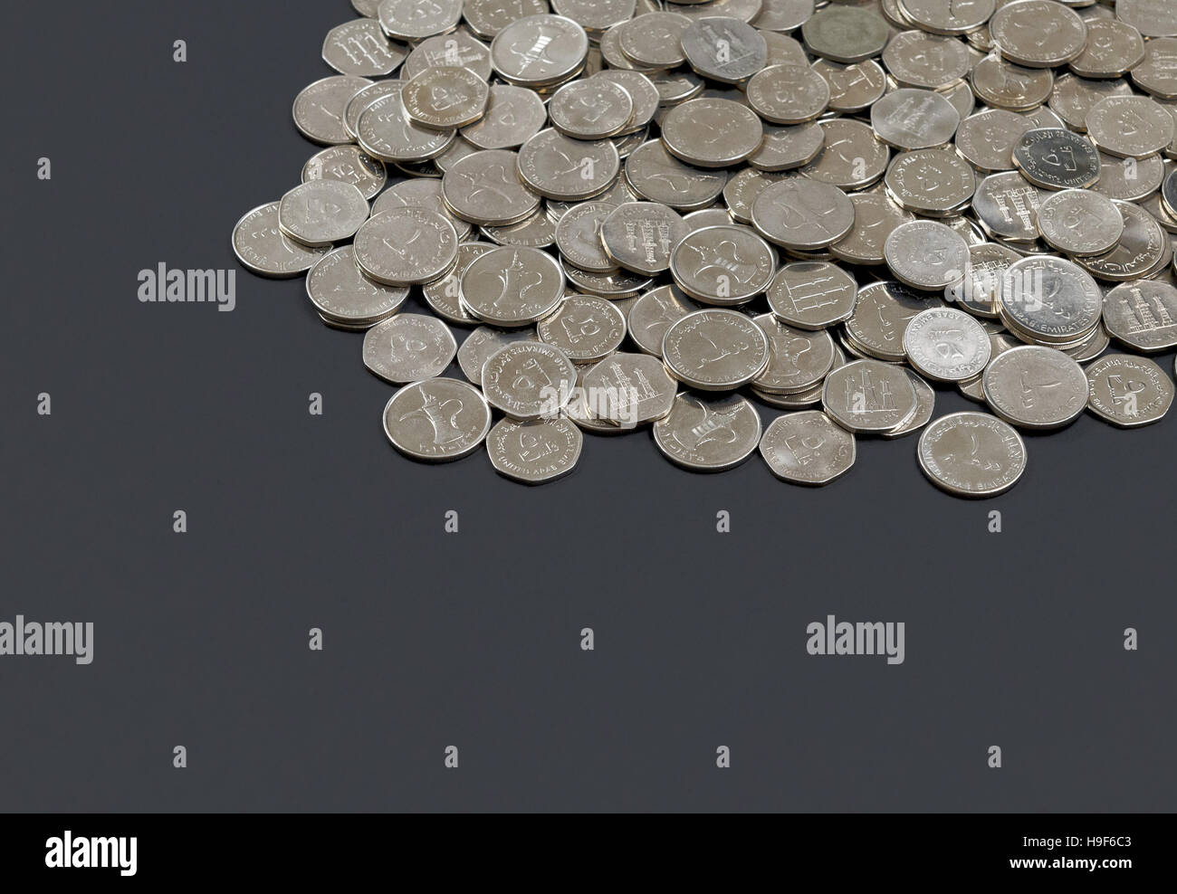 Dubai currency stock photos dubai currency stock images alamy pile of uae dirham coins on dark background stock image biocorpaavc