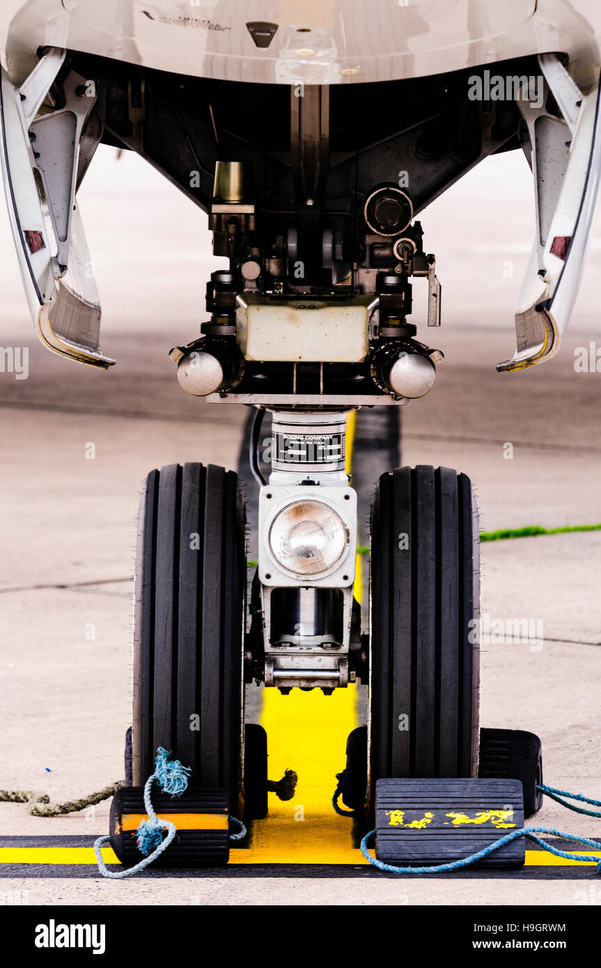 Nose Wheel Of A Boeing 737 With Chocks To Prevent Movement