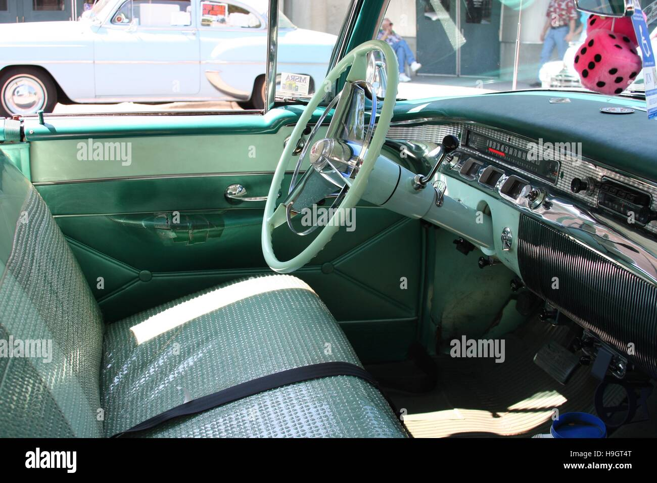 Front seat steering wheel and dashboard of a 1956 buick century hardtop stock