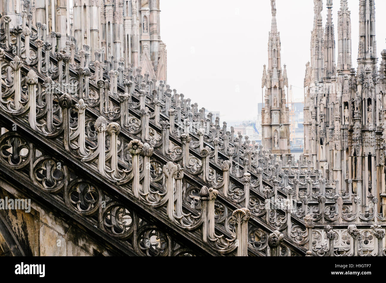 flying buttress stock photos  flying buttress stock images  alamy - flying buttress and ornately carved stonework on the roof of the duomomilano (milan cathedral