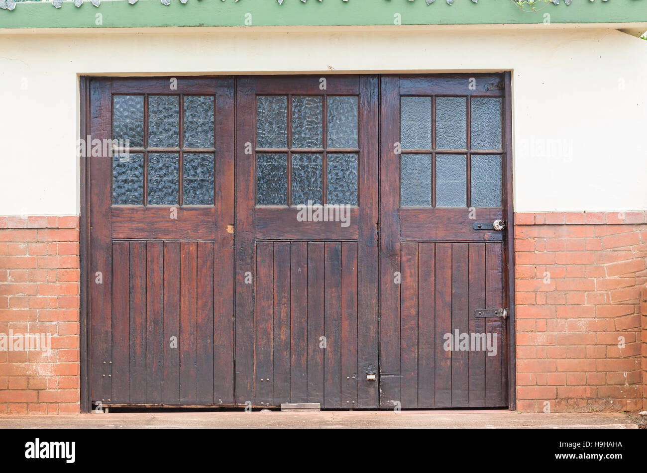 Wood glass crafted vintage garage doors on building outside ...