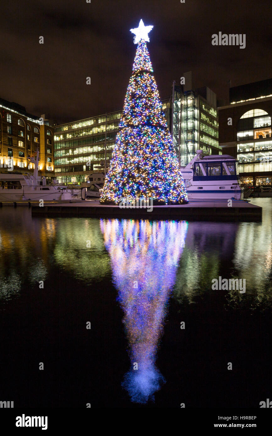 Lights From The Floating Christmas Tree Reflect In The Water At St  Katharine Docks, London, After Being Switched On On Thursday Night. The  Floating